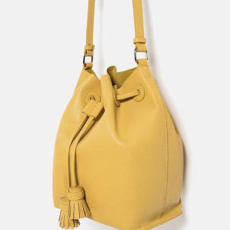 Gele tas met franjes