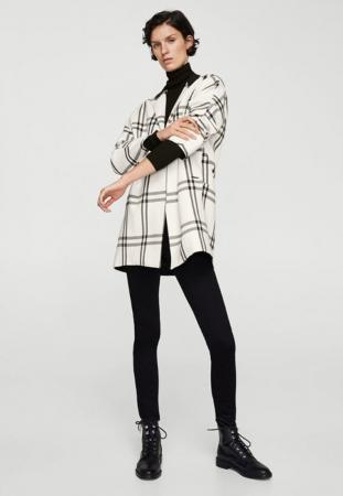 Manteau court noir et blanc à carreaux