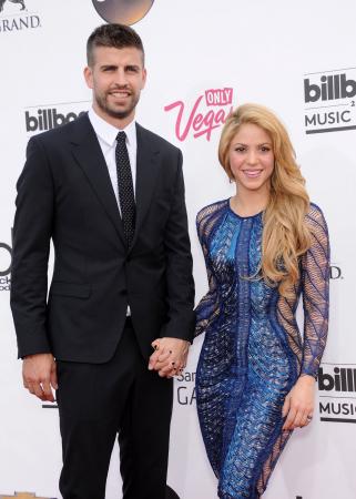 Gerard Piqué (32) en Shakira (42)