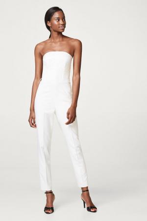 Witte jumpsuit met bustier en sigarettenpijpen