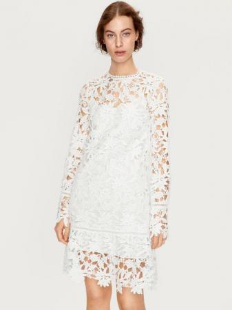 Witte jurk uit broderie anglaise met katoenen onderjurk 'Liana'