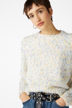 Witte trui met pastelkleurige details
