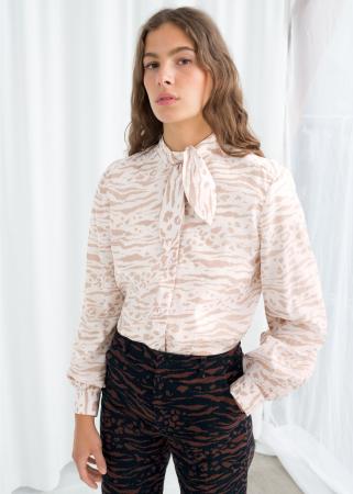 Wit-beige blouse met luipaardprint