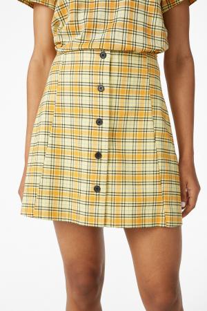 Gele rok met zwarte ruiten en knopen