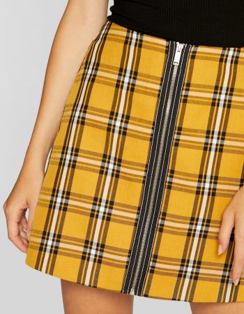Gele rok met zwarte en witte ruiten en rits