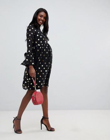 Zwarte jurk met goudkleurigepolkadots