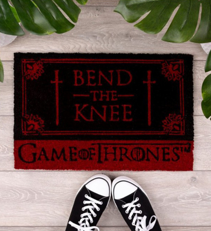 Un paillasson «Bend the knee» (Plie le genou)