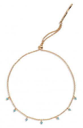 Vergulde armband van 18 karaat met turkooise steentjes