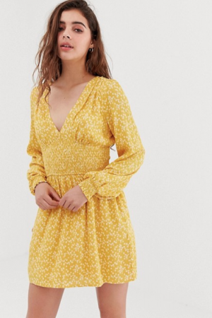 Mosterdgele mini-jurk met bloemenprint