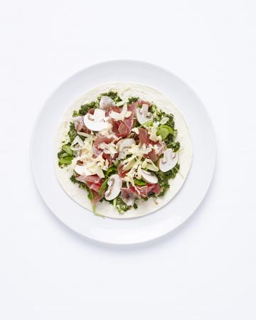 Italiaanse wrap met pesto, parmaham en champignons