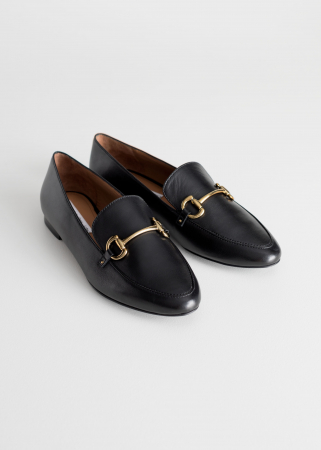 Zwarte loafers met gouden detail