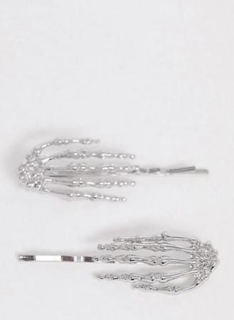Set van twee zilveren speldjes