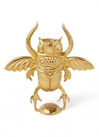 Goudkleurige kandelaar in de vorm van een kever
