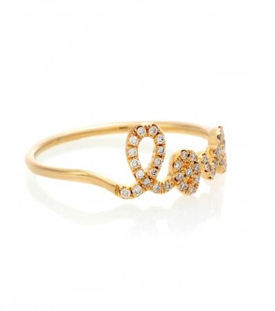 Gouden ring van 14 karaat met opschrift 'love' bezet met diamanten