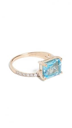 Gouden ring van 14 karaat bezet met diamanten en een blauwe topaas