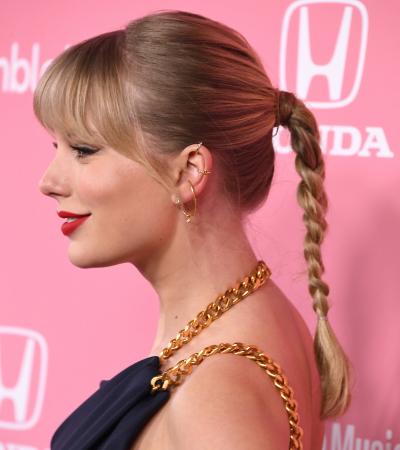 Gevlochten paardenstaart zoals Taylor Swift