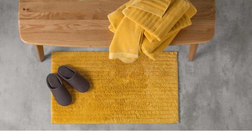 Un tapis de douche en coton biologique