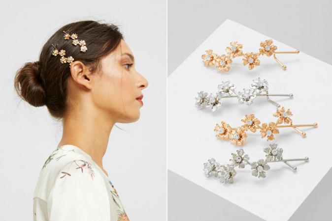 Set van twee goud- en twee zilverkleurige speldjes met bloemen