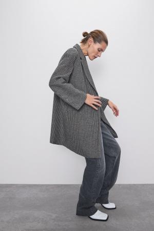 Un manteau à carreaux vichy