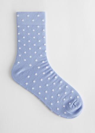 Babyblauwe sokken met witte stippen
