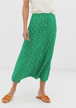 Groen midirok met zwart stippen en knopen