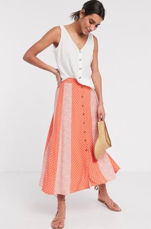 Oranje midirok met polkadots en bloemenprint