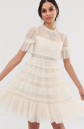 Champagnekleurige midi-jurk met korte mouwen en pailletten