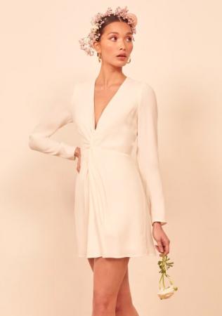 Ivoorkleurige mini-jurk met lange mouwen en V-hals
