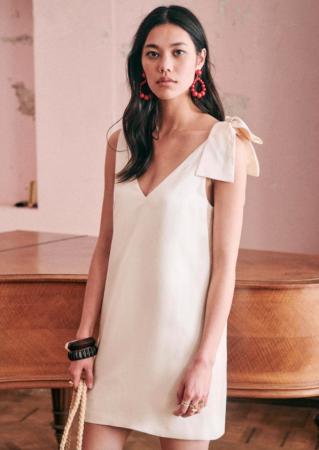 Mouwloze mini-jurk met V-hals in ivoor