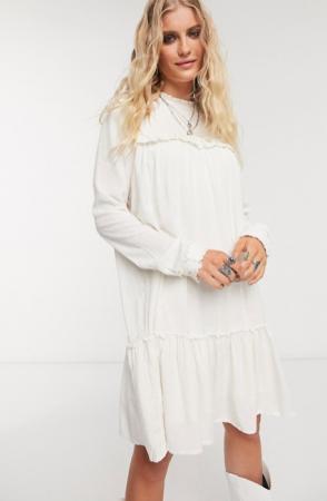 Crèmekleurige mini-jurk met lange mouwen