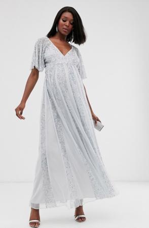 Ijsblauwe maxi-jurk met korte mouwen bezet met pailletten