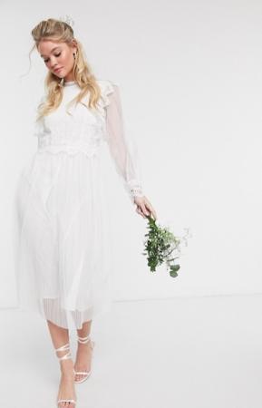 Kanten jurk met transparante mouwen