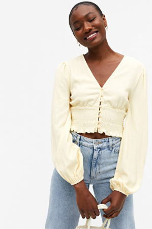 Pastelgele blouse met knopen