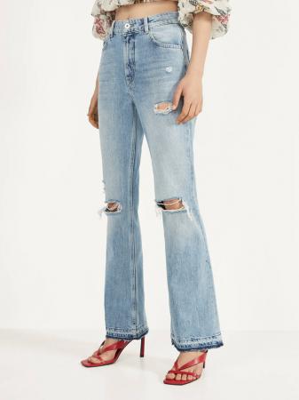 Flared jeans met scheuren
