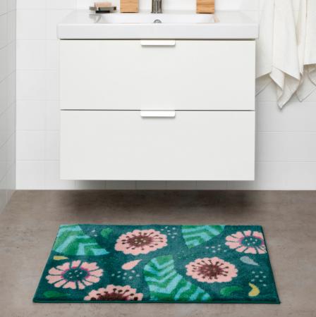 Petroleumblauwe badmat met bloemenpatroon
