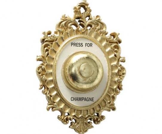 Goudkleurige bel met opschrift 'Press for champagne'