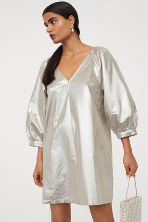 Glanzende jurk