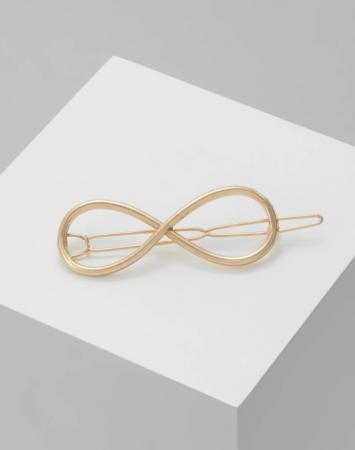 Goudkleurige haarspeld met oneindigheidssymbool