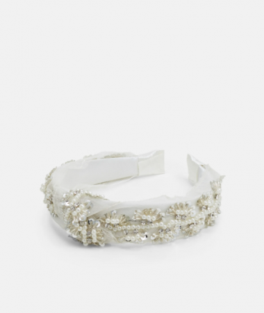 Witte haarband bezet met parels en kralen