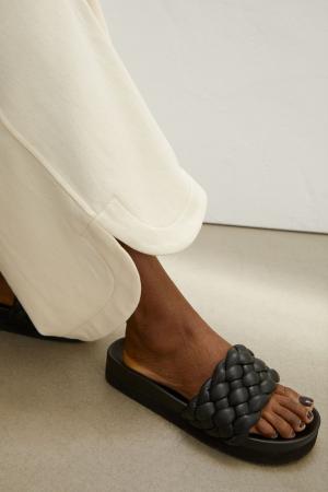 Zwarte slippers met platformzool