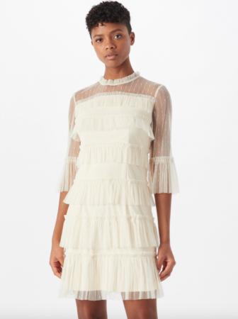 Mini-jurk met transparante mouwen en ruches