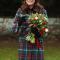 In een jas met tartanmotief van Miu Miu met muts gemaakt van alpaca vanLacorine, oorbellen van Kiki McDonough en handschoenen vanCornelia James