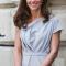 In een ijsblauwe jurk van Roksanda Ilincic met horloge van Cartier, oorbellen van Mappin & Webb en clutch vanL.K.Bennett
