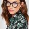 Zwarte bril met roze detail