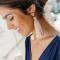 Poederroze oorbellen met kwastjes