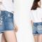 Jeansshortje met madeliefjesprint