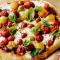 Dinsdag: pizza met kerstomaatjes