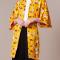 Kanariegele kimono met bloemenprint