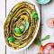 Tian met groene en gele courgette