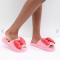 Roze slippers met strikken